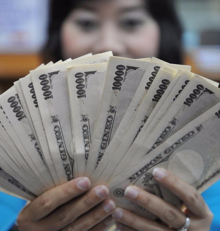 日元昨(15)日一度升至100.9兌1美元。  (圖:AFP)