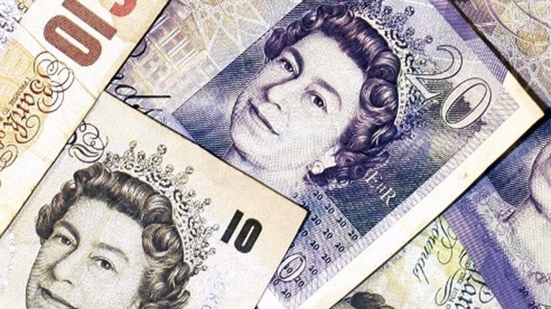 英鎊昨(15)日跌穿1.29美元水平,創1個月新低。  (圖:AFP)