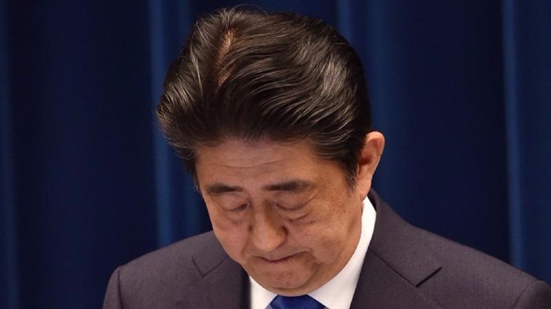 3年下來的安倍經濟學,日本距離2%的通膨目標仍遠。 (圖:AFP)