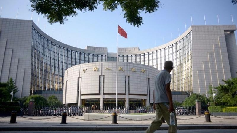 人民銀行、國家外管局昨出新規,放寬RQFII投資A股的額度限制。  (圖:AFP)