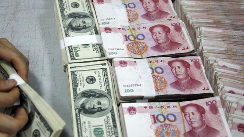人民幣正式納入SDR後配置需求顯現,境外央行類機構近期已兌換逾千億人民幣。  (圖:AFP)