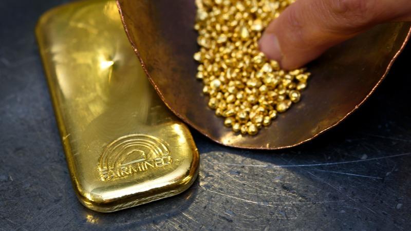 多位分析師對黃金看法不一致。 (圖:AFP)