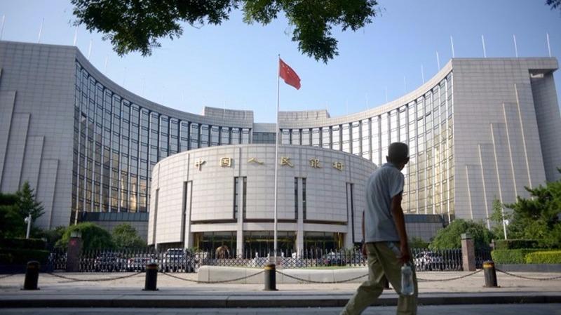 中國央行不斷收緊資金流出管理。  (圖:AFP)
