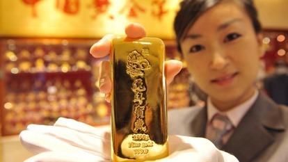中國黃金溢價飆漲,反映市場供應吃緊。(圖片來源:AFP)