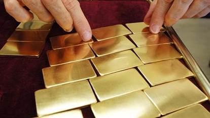 (圖五:2016年的黃金對多頭可真沉重啊,鉅亨網AFP)