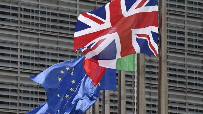 英國開始改變立場,不再要求金融業在脫歐後還能留在單一市場。(圖片來源:AFP)