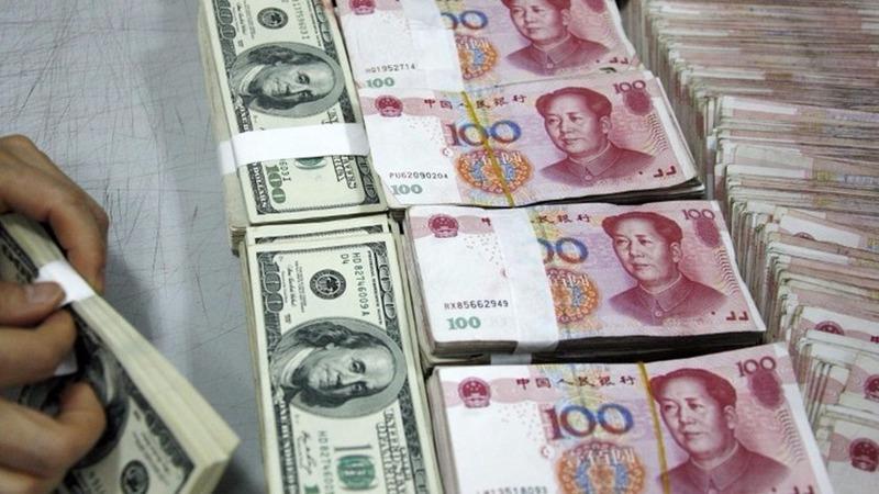 人民幣離岸價(CNH)在亞洲時段尾盤1小時急漲500點子,短線攀升至6.85附近。 (圖:AFP)