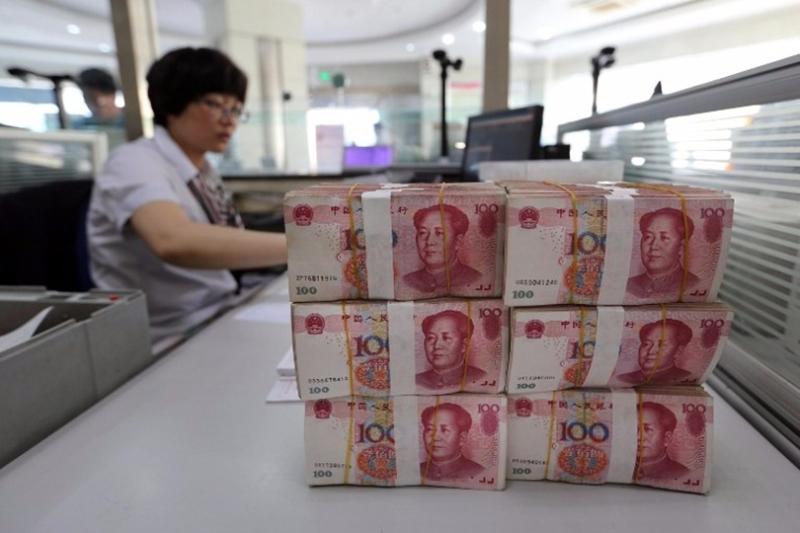 今年1月新增貸款規模達到2.03兆元人民幣,為史上第二個新增信貸超2兆元人民幣的月份。(圖:AFP)