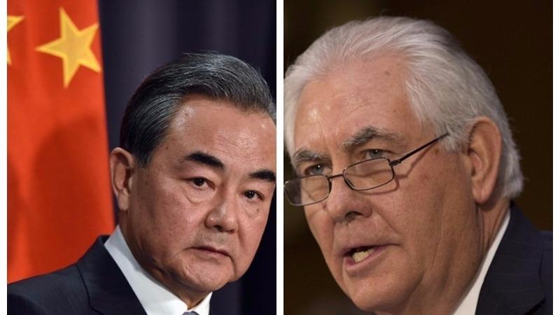 王毅(左)今赴德出席G20外長會議,將美國國務卿蒂勒森會談安排「習川會」。