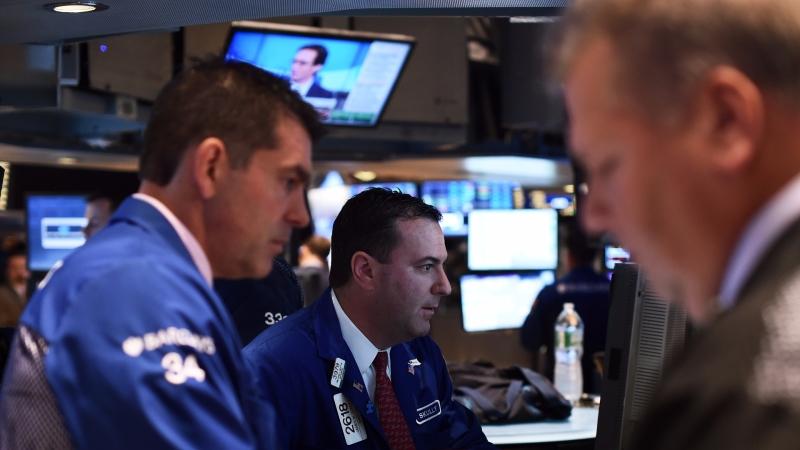 圖:AFP  美國指數期貨週三盤前守穩