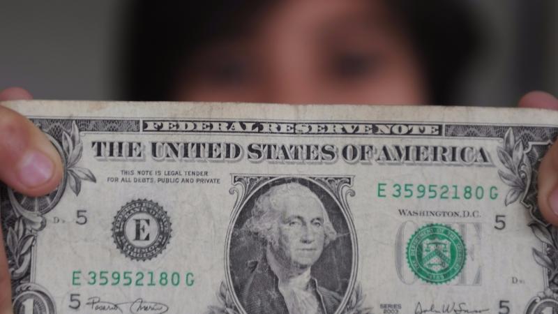 圖:AFP 美元轉強 恐形成問題