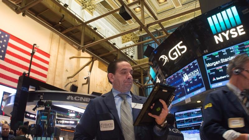 圖:AFP 美國股市週四微幅收高