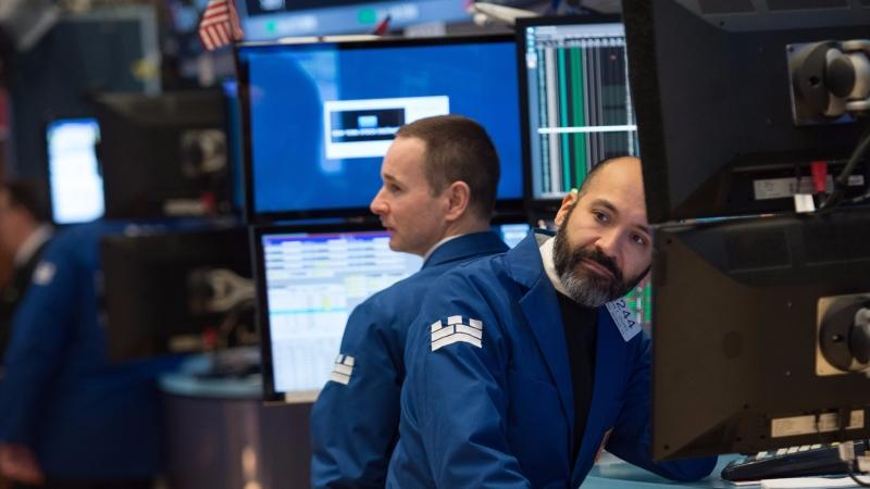圖:AFP 美股週五收盤漲跌互見