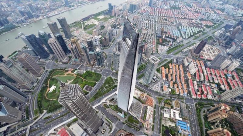 《金融時報》指出,部分城市樓市「高燒」不退,甚至朝着泡沫化方向演變。 (圖:AFP)(