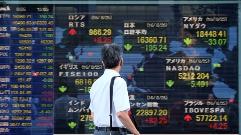 亞股今日漲跌互見,金價小幅上漲,美元受挫。(圖片來源:AFP)