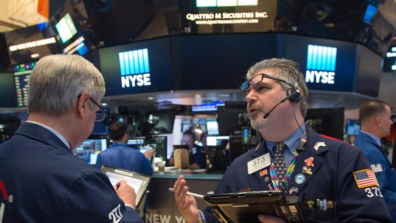 圖:AFP 美股週五漲跌互見