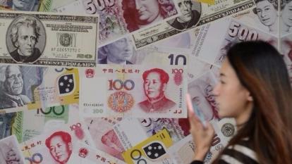 擁有1000萬港元或以上資產後,錢就未必令人更開心。  (圖:AFP)