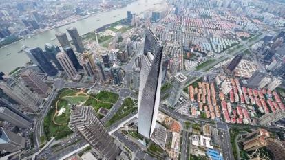 樓市限購政策加壓,上海新房價量均呈現環比兩位數的下跌。 (圖:AFP)