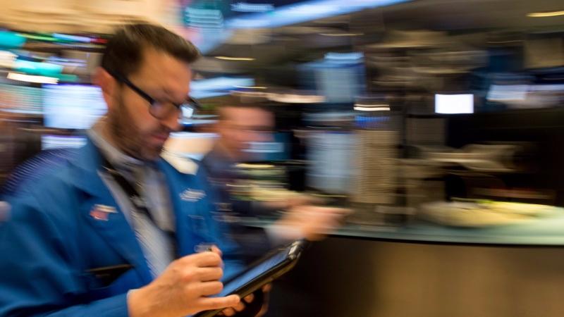 圖:AFP   美國股市周四中場反彈