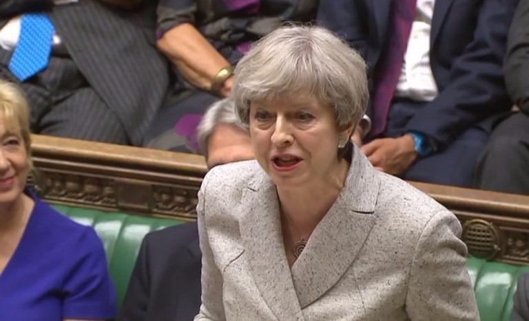 英國首相梅伊批評英倫央行在金融危機後採取的緊急措施,為經濟帶來副作用,並揚言利率將會改變。  (圖:AFP)