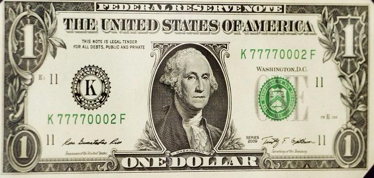 在「布雷頓森林體系」制度之下,各國匯率與美元掛鉤,而美元與黃金儲備掛鉤。  (圖:AFP)