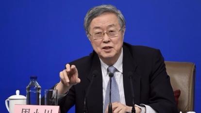 周小川表示,近期人民幣跨境支付系統CIPS將落戶上海。 (圖:AFP)