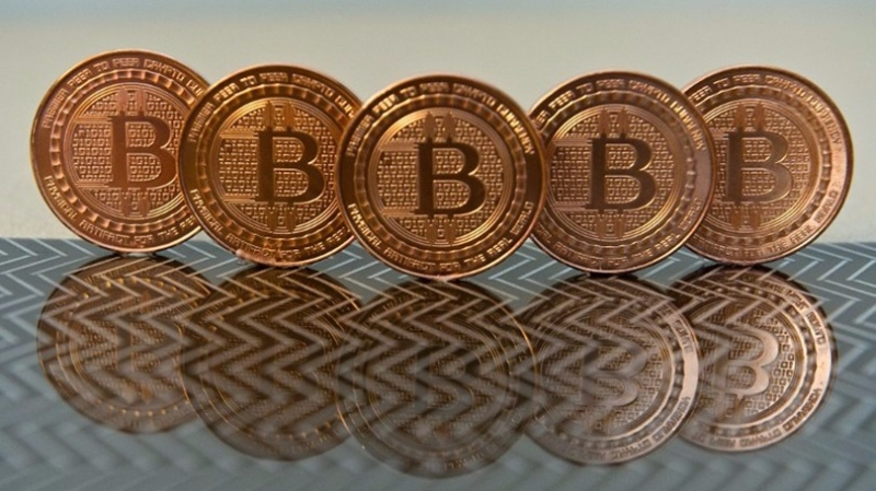人民銀行警告,比特幣等虛擬貨幣全部非法。 (圖:AFP)