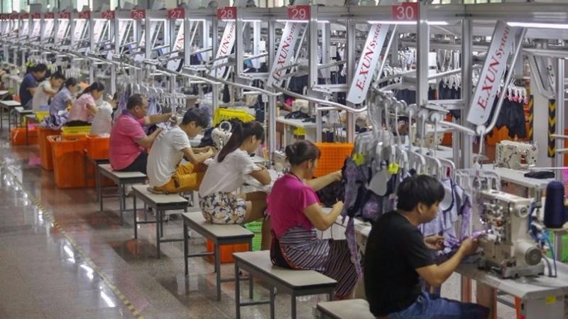 中國12省市上調最低工資標準。  (圖:AFP)