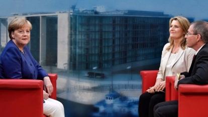 梅克爾接受專訪時表示,若她在今年9月舉行的大選中再度連任,她願繼續幹滿4年任期。 (圖:AFP)