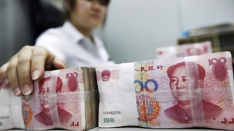 獲利4.5%後出場 投行清空人民幣多頭      (圖:AFP)