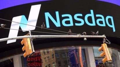 Nasdaq昨天瞬間蹦出個「世界股王」。 (圖:AFP)
