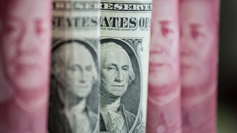 圖:AFP  美元週二溫和上揚