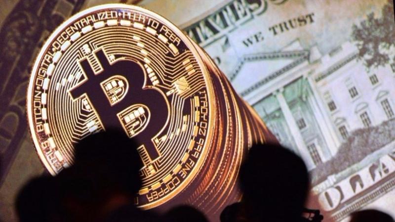 ICOINFO周三(8月30日)突然宣佈暫停一切業務,市場上多個ICO代幣因恐慌出現大跌。 (圖:AFP)