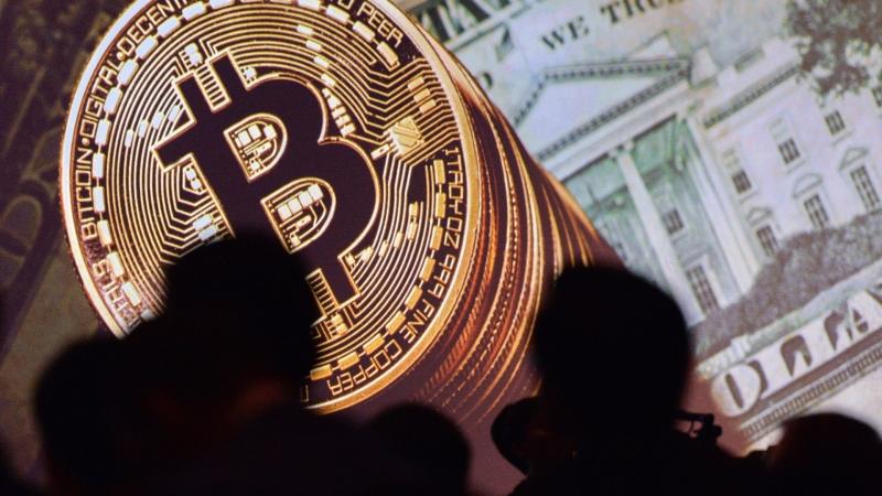 比特幣價格突破5000美元後回調(圖:AFP)