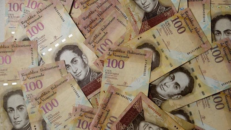 委元在黑市首度貶破 2 萬元兌 1 美元關卡      (圖:AFP)