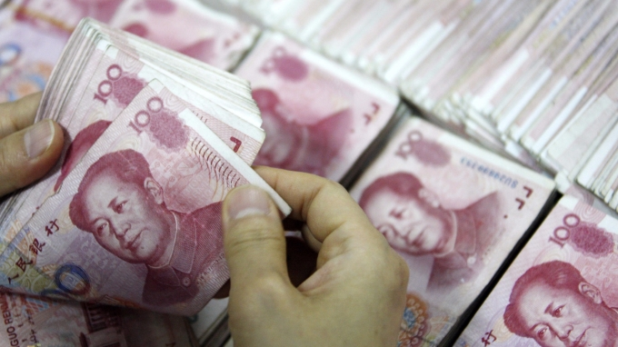 中國國家外匯管理局副局長陸磊指出,金融市場必須服務實體經濟,人民幣匯率會更彈性化。(圖:AFP)