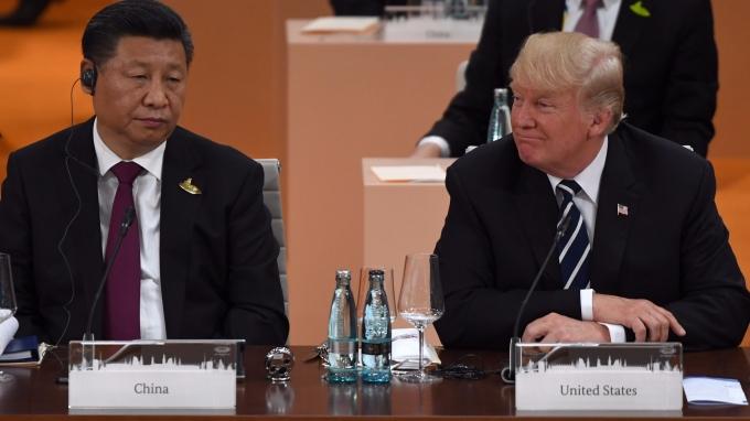 美國總統川普與中國領導人習近平今年 7 月出席 G20 峰會。(AFP)