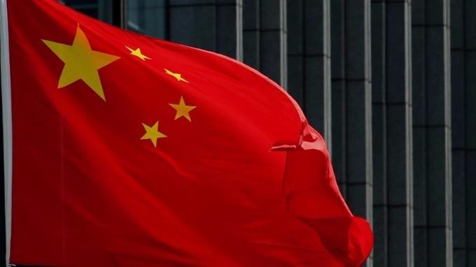 相隔13年,中國財政部9月將重啟在海外發行美元主權債券。 (圖:AFP)