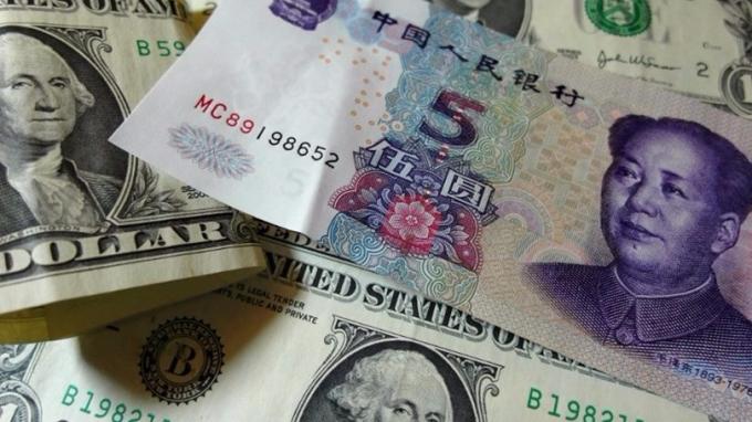 人民幣兌美元中間價14日報6.5465,這續第3天下調。 (圖:AFP)
