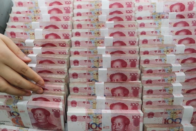 全志剛建議,港股可引進用人民幣計價、交易及結算,以穩定貨幣。 (圖:AFP)
