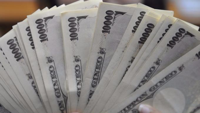 日本攜手各銀行要做自己的虛擬貨幣J-COIN。(圖:AFP)