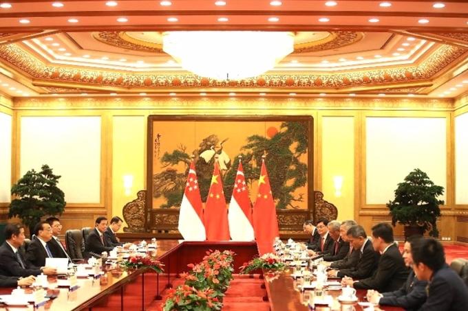 中新雙方同意共同推進區域全面經濟夥伴關係協定(RCEP)商談,加快中新自貿協定(FTA)升級談判。 (圖:AFP)