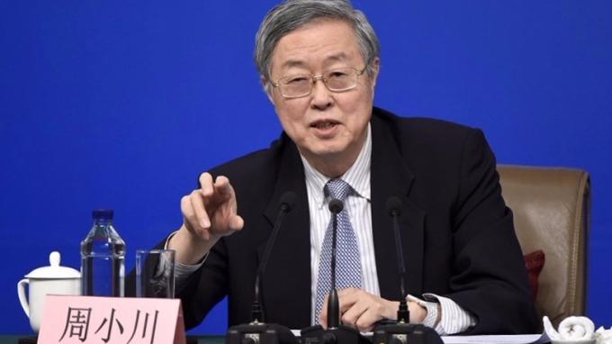 周小川指出,「三駕馬車」駛向開放不可逆,中國將繼續向前推進匯率制度改革。 (圖:AFP)