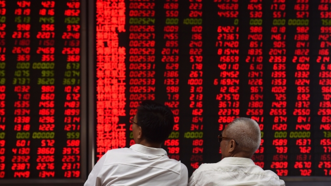 野村分析國際投資人提升中國股票配置的原因。(圖:AFP)