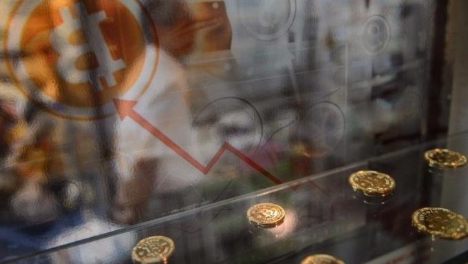 比特幣價格重回5000美元之上(圖:AFP)