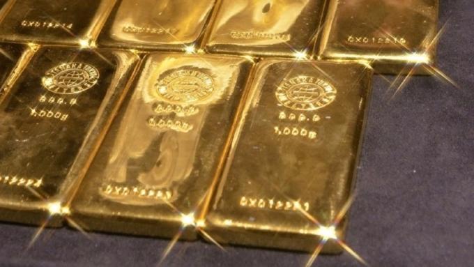 黃金連三跌,離1300美元越來越遠      (圖:AFP)