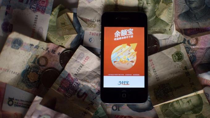 新金融的破壞式創新,揭開傳統金融業與FinTech新創企業一場哈士奇與狼的戰爭(圖:AFP)