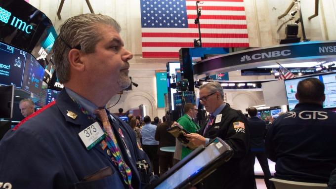 圖:AFP  美國股市中場溫和上揚