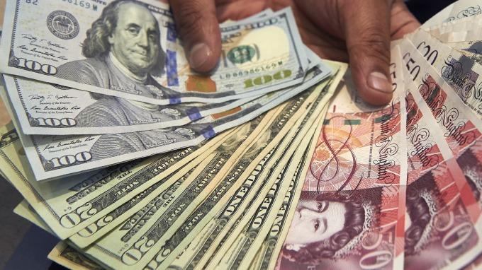 圖:AFP  美元週二下跌 歐元則上漲