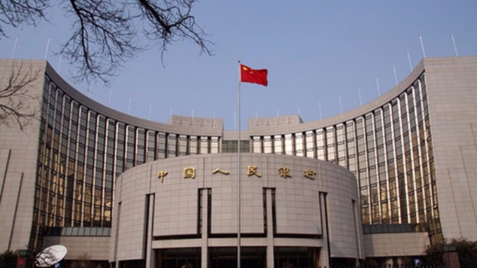昨日央行公開市場淨投放1400億元人民幣,資金面略有收緊。 (圖:AFP)